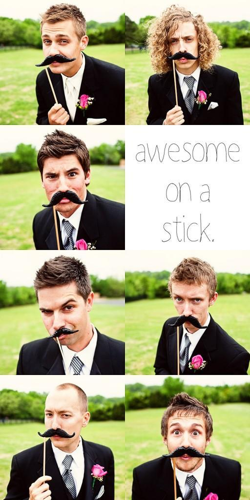 Mustache-on-a-stick-fun-at-wedding-reception-groomsmen.full