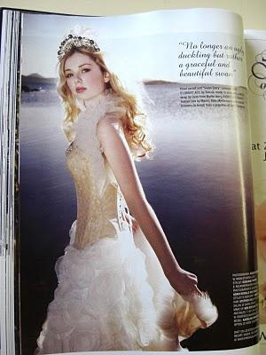 Romantic bridal look with ivory gold corset and full flouncy ballgown skirt