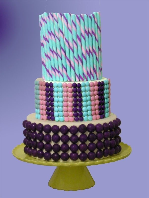 This Two Tiered Wedding Cake In Shades Of Pink Purple And Blue Is