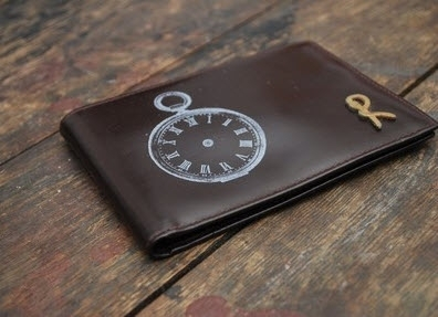 Brown wallet made from recycled leather- a great eco-friendly groomsmen gift!
