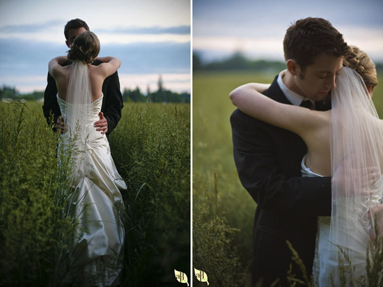 Bride and groom get some romatic wedding shots during sunset in an open field