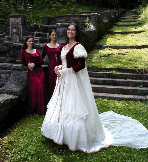 This red and white Renaissance themed wedding dress is from Kristina Marie designs. The bridesmaids
