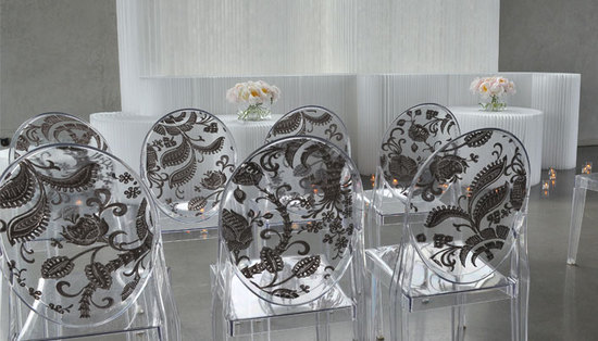 Modern and elegant clear ceremony chairs with black pattern on back