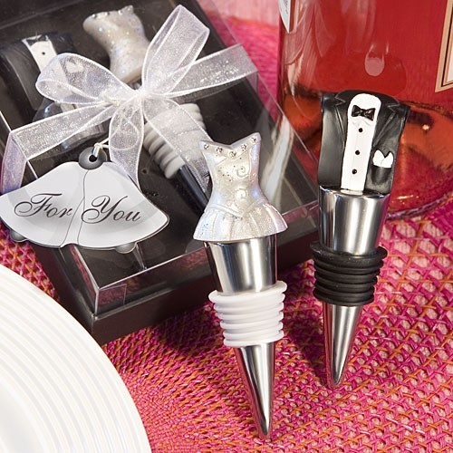 Give your wedding guests an adorable bride and groom wine stopper set