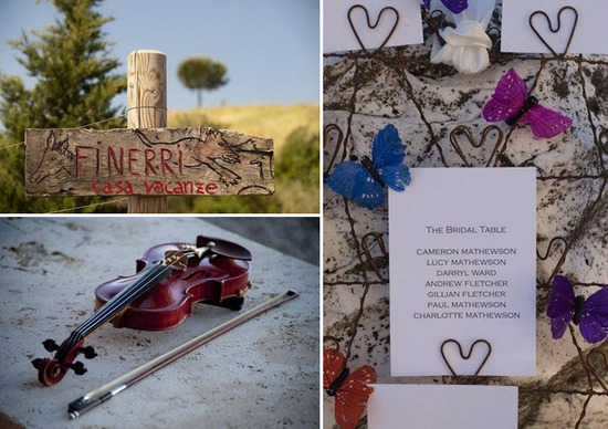 Gorgeous wedding details- violin sits on stone wall; bridal table cards with purple and blue butterf