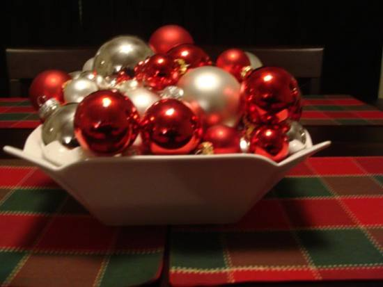 photo of These red, white, and silver ornaments create a Christmas themed centerpiece perfect for a holiday w