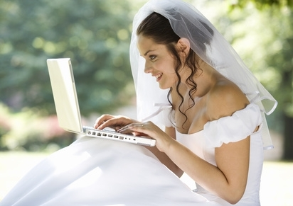 This traditional looking bride is using the internet and computers to plan her wedding.