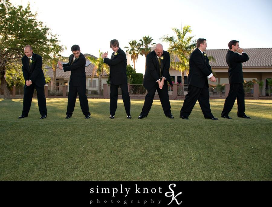 groom and groomsmen pose in best golf positions while wearing