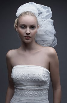This futuristic and modern white wedding veil from Watters is still wearable as seen on this bride i