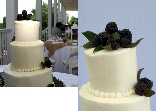 This classic three-tiered white wedding cake is garnished simply with fresh blackberries.