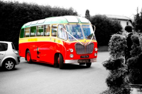 This red and yellow British bus provides quaint wedding day transportation for wedding guests.