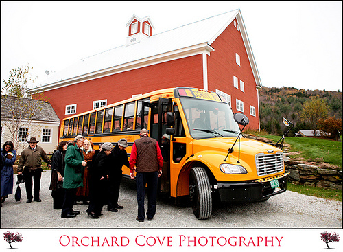 This yellow school bus is being used to transport wedding guests from this beautiful red barn weddin