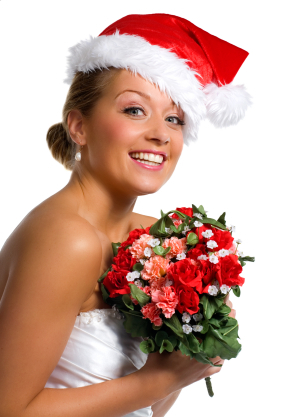This bride's pink and red rose bouquet and santa hat have her ready to be a Christmas bride.