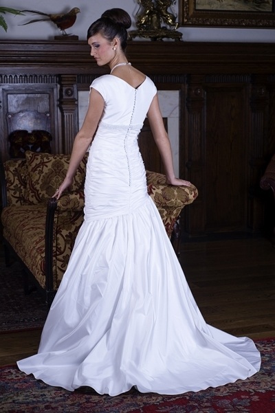 Beautiful silk mermaid modest wedding dress with covered buttons down the back