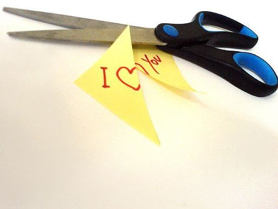 These scissors cutting a small I love you note symbolizes what happens when there's marital infideli