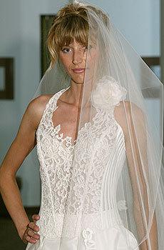 Bridal-fashion-style-wedding-dress-neckline-pointed-halter-white-large-rosette-on-shoulder.full