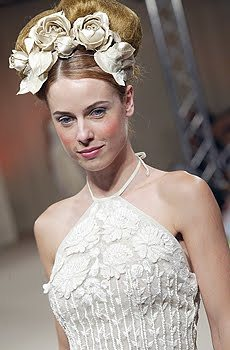 Ivory wedding dress from Atelier Aimee with v-halter neckline and floral appliques