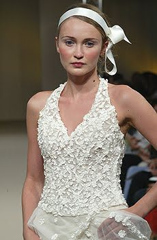 White wedding dress with textured bodice, and modified bib-halter neckline