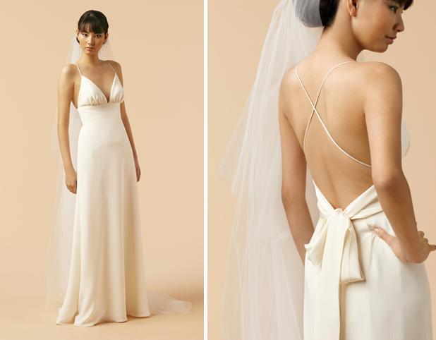 Sheath style v-neck ivory wedding dress with open back, perfect for a beach wedding