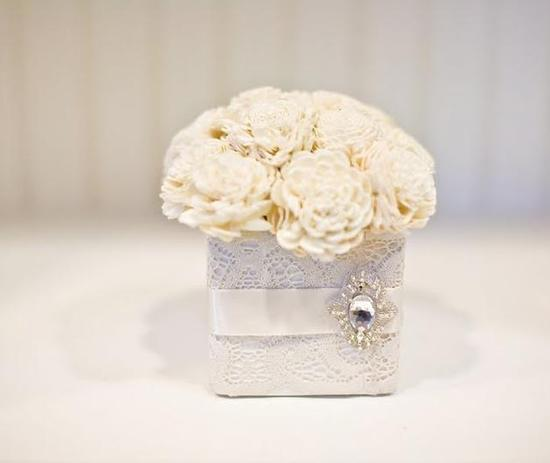 Beautiful ivory balsa wood flowers in a white lace square box, adorned with rhinestone brooch