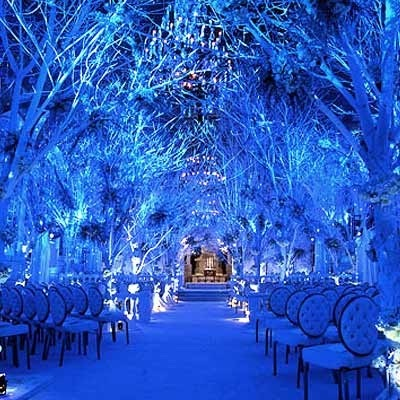 This winter wonderland wedding uses white and blue to dramatic effect. It is NOT DIY.