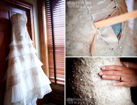 Beautiful vintage-inspired ivory beaded strapless wedding dress hangs on door; something blue peeks