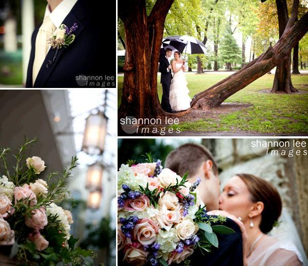 Groom in black tux and ivory tie; bride and groom pose under black and white umbrella amid beautiful