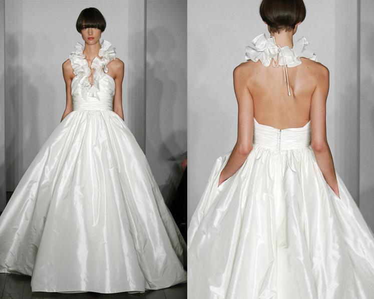 White ballgown wedding dress from Amsale with ruffled halter neckline and pockets