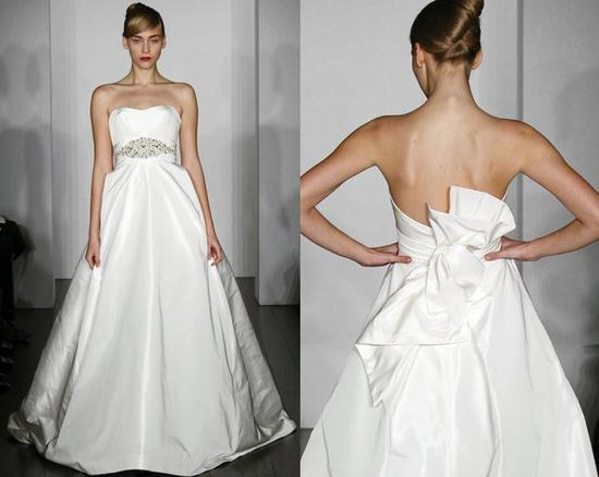 Beautiful white strapless ballgown wedding dress with crystal beading at the waist
