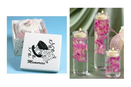 Cute mini cake boxes and glass cylinder tealight holders filled with pink orchids