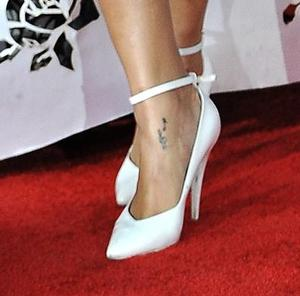 photo of From the Red Carpet to the Wedding Aisle: Rihanna's White Hot Shoes at the AMA's!