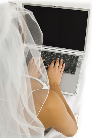 This smart bride is using the computer to plan her wedding.