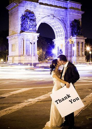 Say-thank-you-to-your-wedding-guests-romantic-bride-groom-kiss-under-arch.full