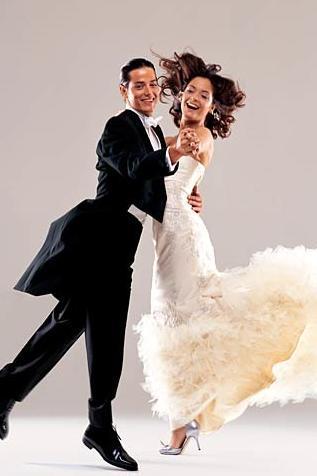 Dresses-for-dancing-ballroom-demetrios-ivory-ruffly-wedding-dress-strapless-groom-in-tux.full