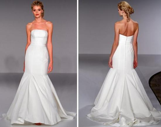 White strapless drop waist wedding dress with trumpet skirt, and covered buttons