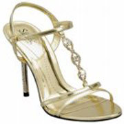 This gold bridesmaid shoe is in a sandal form with a hint of gladiator sexiness.