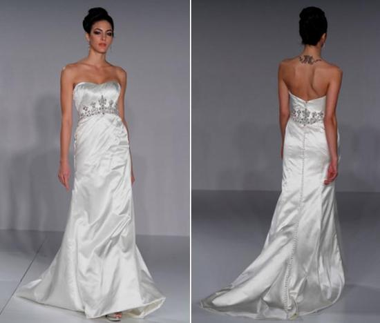 Beautiful diamond white strapless wedding dress with silver and jeweled beading under bust