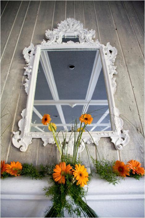 Jagger-wedding-detail-shot-antique-vintage-feel-mirror-with-white-frame-orange-flowers.full