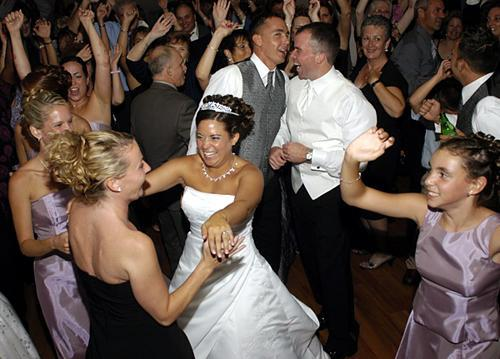 The age old dilemma- wedding band vs. wedding dj