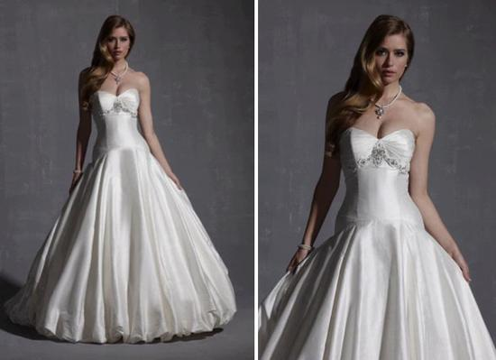 Strapless sweetheart neckline wedding dress with full ball gown skirt and silver embroidered details