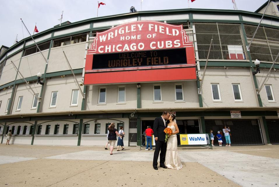 Bride And Groom Kiss In Front Of Chicago S Wrigley Field