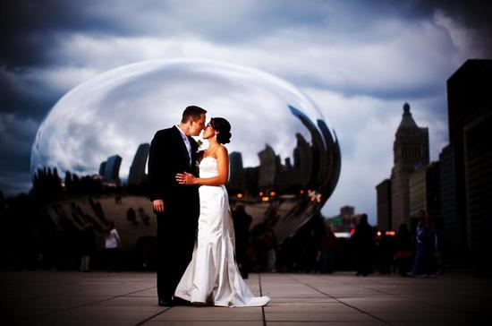 "Bride and groom pose in Millennium Park in front of ""The Bean"""