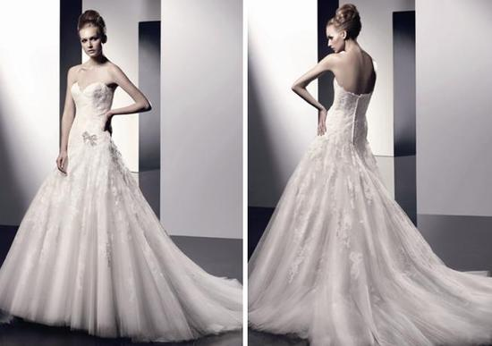 Beautiful drop waist strapless wedding dress with tulle, lace and a silver bow brooch