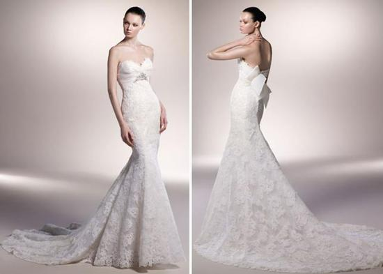Beautiful ivory lace mermaid wedding dress with sweetheart neckline and silver brooch