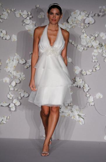 Short destination wedding dress with deep v halter, tiered knee-length skirt