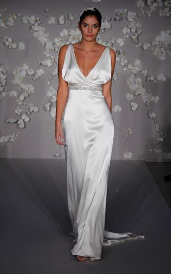 Slinky, glamourous ivory a-line wedding dress with deep v cowl neck, and crystal, rhinestone band un