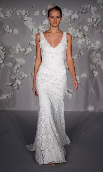 Beautiful trumpet wedding dress with all over lace, open back, deep v neckline and chapel train