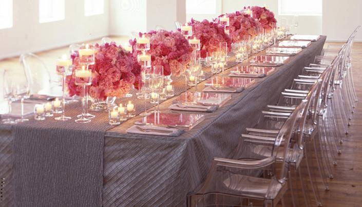 Stunning wedding reception tablescape with pink fuschia