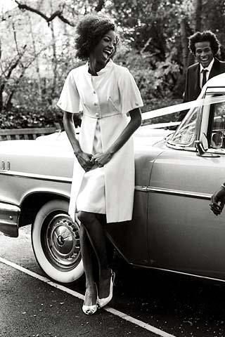 Vintage-feel-antique-car-black-and-white-knee-length-coatdress-white-peep-toe-bridal-heels.full