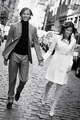 Black-white-knee-length-white-coatdress-italy-european-vibe-bride-groom-hold-hands.full